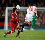 Mohamed Salah of Liverpool tussles with Sergio Escudero of Sevilla during the Champions League Group E match at the Anfield Stadium, Liverpool. Picture date 13th September 2017. Picture credit should read: Simon Bellis/Sportimage