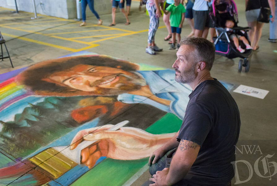 NWA Democrat-Gazette/CHARLIE KAIJO Artist Jeff Pilkinton (right) takes a break from finishing his chalk art piece during the first annual chalk festival, Sunday, August 10, 2019 at Crystal Bridges in Bentonville. <br /> <br /> 23 professional chalk artists turned concrete into masterpieces at Crystal Bridges. The artists finished their pieces on Sunday with some 4,000 visitors attending the two-day event. Attendees also enjoyed live music, food trucks and a kids chalking area.