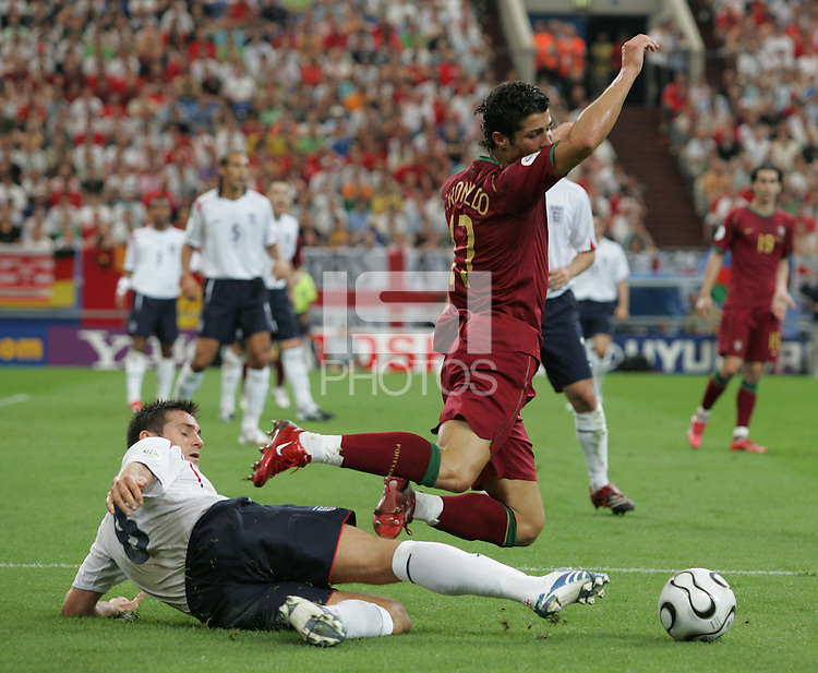 Portuguese forward (17) Cristiano Ronaldo is tackled by English midfielder (8) Frank Lampard.  Portugal defeated England on penalty kicks after playing to a 0-0 tie in regulation in their FIFA World Cup quarterfinal match at FIFA World Cup Stadium in Gelsenkirchen, Germany, July 1, 2006.