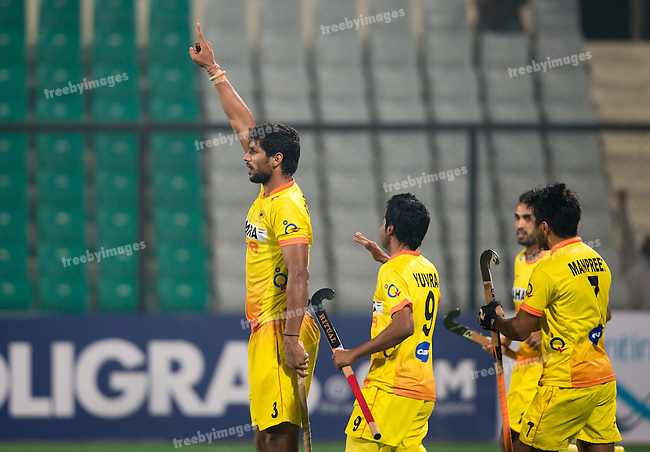 Mens Hockey World league Final Delhi 2014<br /> Day 3, 12-01-2014<br /> Indian v Germany Day 3<br /> Rupinder Pal Singh goals for India<br /> Photo: Grant Treeby / treebyimages