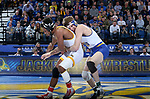 BROOKINGS, SD - JANUARY 18: Luke Zilverberg from South Dakota State University grabs Archie Colgan from Wyoming during their 157 pound match Thursday night at Frost Arena in Brookings. (Photo by Dave Eggen/Inertia)