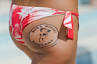 Participant Szabina Szimpla wears the logo of the contest on hear body during the Miss Bikini Hungary beauty contest held in Budapest, Hungary on August 06, 2011. ATTILA VOLGYI
