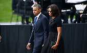 United States President Barack Obama and first lady Michelle Obama arrive at a memorial for the victims of the Washington Navy Yard shooting at the Marine Barracks, September 22, 2013 in Washington, D.C..The President and First Lady also visited with families of the victims. <br /> Credit: Olivier Douliery / Pool via CNP