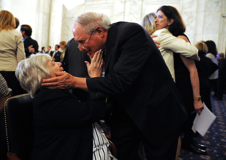Shirley Metzenbaum, wife of former Senator Howard Metzenbaum, D-Ohio, greets Sen. Carl Levin, D-Mich., before a memorial service for her late husband who died in March of this year, July 15, 2008.