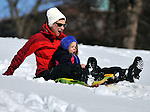 (Boston, Ma 030913)   Marcy Axelrad of Boston, having a grand time sledding with her daughter Jordan Whitney 3, Saturday, March 9, on the Boston Common. (Jim Michaud /Photo) For Sunday
