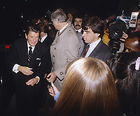 Washington DC., USA, 1981<br /> President Ronald Reagan after going to dinner at a private resisdence works a rope line shaking hands with neighborhood children Credit: Mark Reinstein/MediaPunch