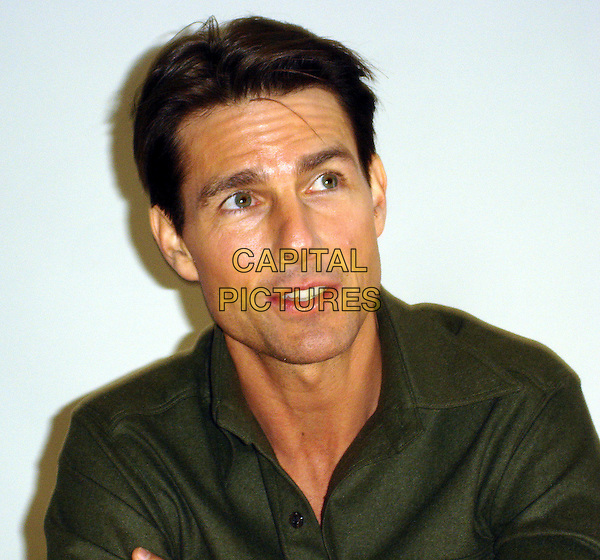 "TOM CRUISE.Press conference for ""Valkyrie"", Four Seasons, Los Angeles, California, USA..November 20th, 2008          .headshot portrait green shirt collar.CAP/AW.©Anita Weber/Capital Pictures."