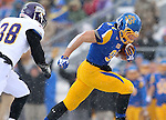 BROOKINGS, SD - NOVEMBER 15: Zach Zenner #31 from South Dakota State University slips past David Griffith #38 from Western Illinois for a touchdown in the second quarter Saturday afternoon at Coughlin Alumni Stadium in Brookings. (Photo by Dave Eggen/Inertia)
