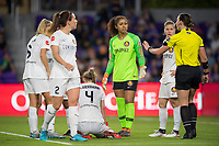 Orlando, FL - Saturday March 24, 2018: The referee and Utah Royals FC teammates check on the injury to Utah Royals defender Becky Sauerbrunn (4) during a regular season National Women's Soccer League (NWSL) match between the Orlando Pride and the Utah Royals FC at Orlando City Stadium. The game ended in a 1-1 draw.