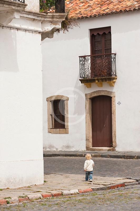 Uruguay, Colonia del Sacramento, Small boy on street corner, Historic District