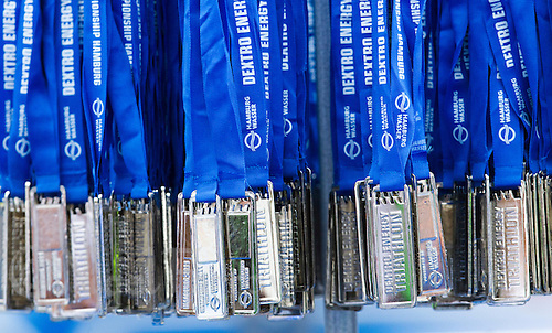17 JUL 2011 - HAMBURG, GER - Medals for the finishers of the Jedermann Olympische Distanz hang from a rack .(PHOTO (C) NIGEL FARROW)