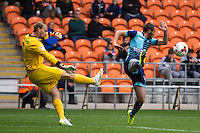 Michael Harriman of Wycombe Wanderers nearly charges down Sam Slocombe of Blackpool clearance during the Sky Bet League 2 match between Blackpool and Wycombe Wanderers at Bloomfield Road, Blackpool, England on 20 August 2016. Photo by James Williamson / PRiME Media Images.