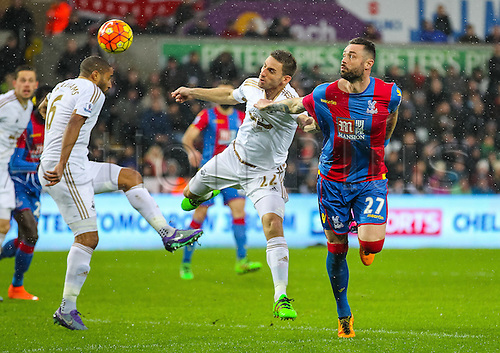 06.02.2016. Liberty Stadium, Swansea, Wales. Barclays Premier League. Swansea versus Crystal Palace. Crystal Palace's Damien Delaney heads the ball towards the Swansea goal past Williams