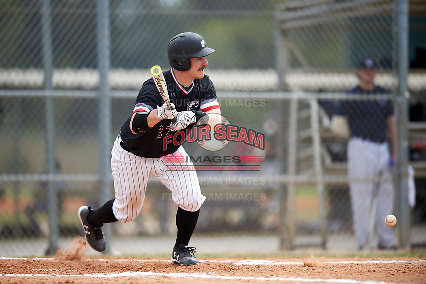 Edgewood College Eagles Nick Cheaney (27) lays down a bunt during the first game of a doubleheader against Western Connecticut Colonials on March 13, 2017 at the Lee County Player Development Complex in Fort Myers, Florida.  Edgewood defeated Western Connecticut 3-0.  (Mike Janes/Four Seam Images)