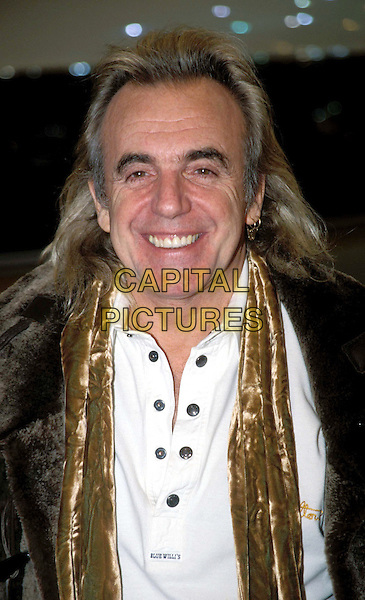 PETER STRINGFELLOW.Ref: 6987/0801H.long hair, buttons, gold scarf, headshot, portrait.www.capitalpictures.com.sales@capitalpictures.com.© Capital Pictures.