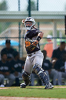 GCL Yankees 2 catcher Eduardo Navas (79) throws to first during the first game of a doubleheader against the GCL Pirates on July 31, 2015 at the Pirate City in Bradenton, Florida.  GCL Pirates defeated the GCL Yankees 2 2-1.  (Mike Janes/Four Seam Images)