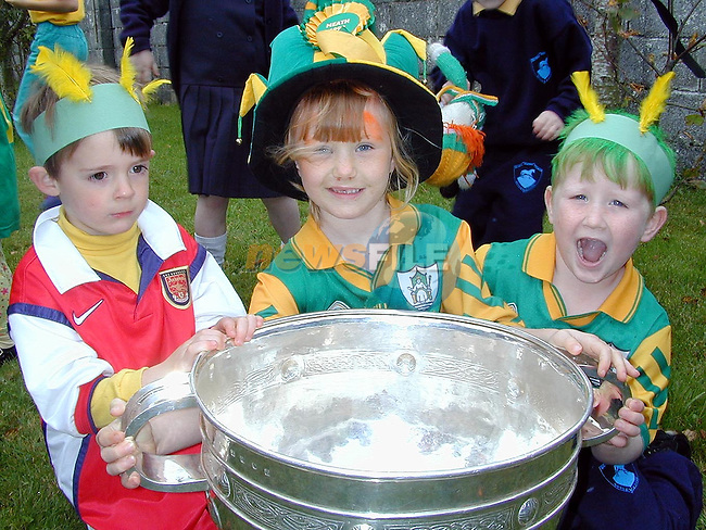 Karl Brannigan, Bellewstown, Rachel Andrews, Duleek and Ben Lynch, Bellewstown with the Sam Maguire in Scoil Naomh Treasa, Bellewstown on Thursday..Picture Paul Mohan Newsfile