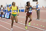 COLLEGE STATION, TX - MARCH 11: Raevyn Rogers of Oregon and Kendall Ellis of Southern California compete in the women's 4x400 meter relay during the Division I Men's and Women's Indoor Track & Field Championship held at the Gilliam Indoor Track Stadium on the Texas A&M University campus on March 11, 2017 in College Station, Texas. (Photo by Michael Starghill/NCAA Photos/NCAA Photos via Getty Images)