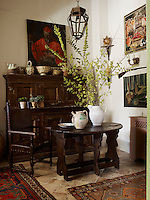 A 16th century table is teamed with a 17th century chair and cabinet in a corner of the kitchen