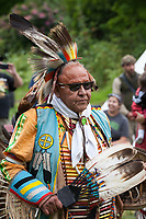 Native American Man wearing Feather Headdress, Northwest Folklife Festival 2015, Seattle Center, Washington, USA.