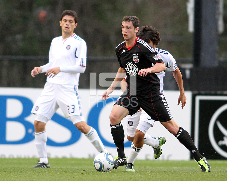 Blake Brettechneider#29 of D.C. United pushes the ball away from Calen Carr#3 and Josip Mikulic#23 of the Chicago Fire during a second round match of the Carolina Challenge on March 9 2011 at Blackbaud Stadium, in Charleston, South Carolina. D.C. United won 1-0.
