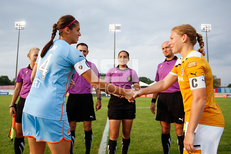 Brittany Taylor (14) of Sky Blue FC and Lori Chalupny (17) of the Atlanta Beat shake hands after the coin toss. Sky Blue FC defeated the Atlanta Beat 1-0 during a Women's Professional Soccer (WPS) match at Yurcak Field in Piscataway, NJ, on June 22, 2011.