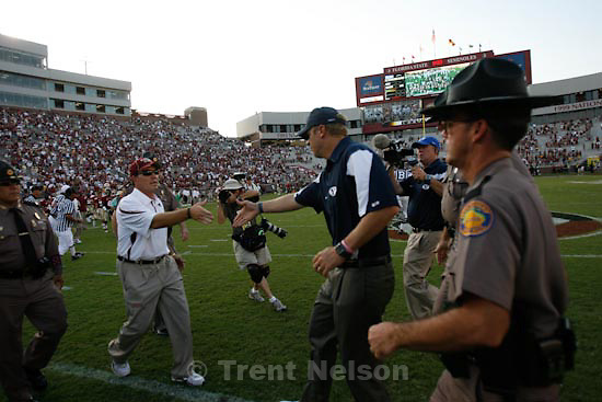 Trent Nelson  |  The Salt Lake Tribune.BYU coach Bronco Mendenhall walks off after shaking hands with Florida State coach Jimbo Fisher (left), BYU vs. Florida State, college football Saturday, September 18, 2010 at Doak Campbell Stadium in Tallahassee, Florida.
