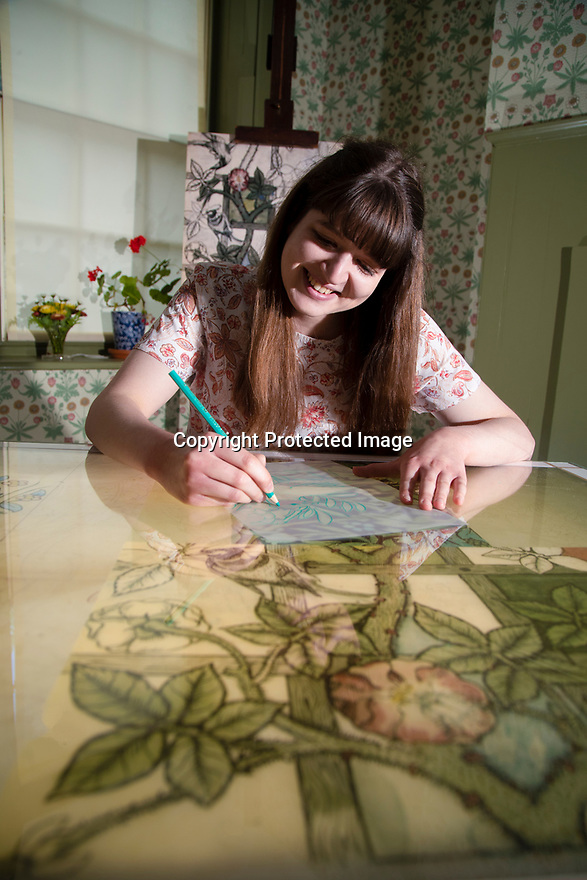 29/05/15<br /> <br /> Alice Johnson using the interactive table in the Living Artist's Studio.<br /> <br /> Morris & Co. Inspired by Nature at Standen House and Garden, the National Trust's Arts and Craft House in East Grinstead, West Sussex delves in to the World of Morris & Co. Discover how repeating patterns of flowers and birds were chosen for the designs and the value that Morris placed on the revival of traditional skill. 1 Jun - 10 Nov 2019.<br /> <br /> All Rights Reserved: F Stop Press Ltd. +44(0)1335 418365   +44 (0)7765 242650 www.fstoppress.com