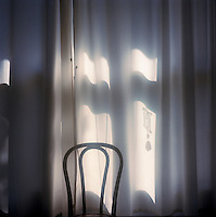 Bistro chair and curtain