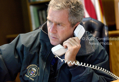 United States President George W. Bush speaks on the telephone with President Vladimir Putin of Russia from Camp David, the Presidential retreat near Thurmont, Maryland, Saturday, September 22, 2001. .Credit: Eric A. Draper - The White House / CNP