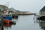 Small boats at a dock with fog in the distance, Peggy's Cove, Nova Scotia