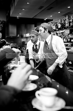 Baristas working at Castroni bar on Via Nazionale, Rome, hugely popular bar where you can savour the finest quality artisan coffee.