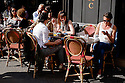 Paris, France. 09.05.2015. People enjoying the sunshine outside a Montmartre cafe. Photograph © Jane Hobson