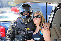 Jun. 16, 2012; Bristol, TN, USA: NHRA top fuel dragster driver Scott Palmer with crew member during qualifying for the Thunder Valley Nationals at Bristol Dragway. Mandatory Credit: Mark J. Rebilas-