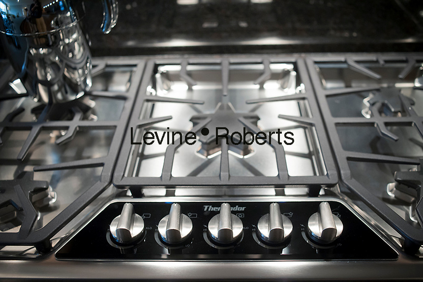 Natural gas burners on a high end Thermador kitchen stove set into a countertop is seen in a New York apartment on Saturday, October 6, 2012. (© Richard B. Levine)