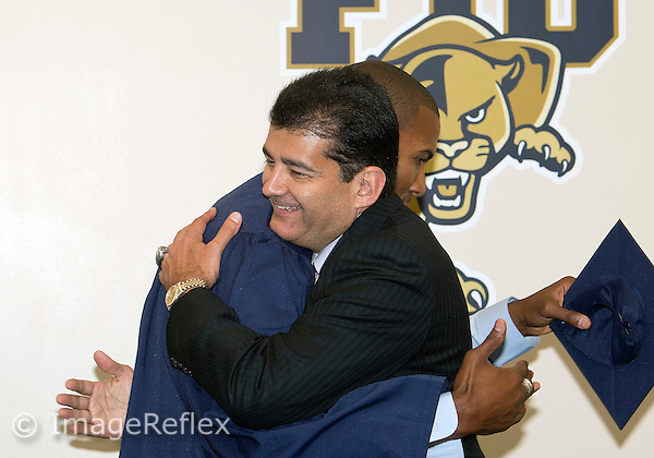 Florida International University (1997-1999) and present NBA basketball player Raja Bell at his graduation with Athletic Director, Pete Garcia on August 13, 2012 at Miami, Florida. .