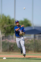 Texas Rangers third baseman Tyler Ratliff (32) makes a throw to first base during an Instructional League game against the San Diego Padres on September 20, 2017 at Peoria Sports Complex in Peoria, Arizona. (Zachary Lucy/Four Seam Images)