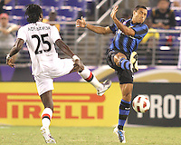 Ivan Cordoba #2 of Inter Milan boots the ball away from Emmanuel Adebayor #25 of Manchester City during an international friendly match on July 31 2010 at M&T Bank Stadium in Baltimore, Maryland. Milan won 3-0.