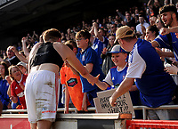 Ipswich Town's Callum Elder giving a young fan his shirt<br /> <br /> Photographer Hannah Fountain/CameraSport<br /> <br /> The EFL Sky Bet Championship - Ipswich Town v Swansea City - Monday 22nd April 2019 - Portman Road - Ipswich<br /> <br /> World Copyright © 2019 CameraSport. All rights reserved. 43 Linden Ave. Countesthorpe. Leicester. England. LE8 5PG - Tel: +44 (0) 116 277 4147 - admin@camerasport.com - www.camerasport.com