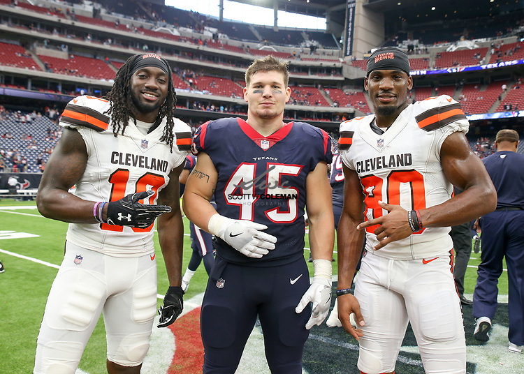 Former Auburn Tigers Cleveland Browns wide receiver Sammie Coates (10), Houston Texans fullback Jay Prosch (45) and Cleveland Browns wide receiver Ricardo Louis (80), get together at midfield following an NFL game between the Houston Texans and the Cleveland Browns at NRG Stadium in Houston, Texas.