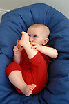 Berkeley CA  Baby girl six months old analyzing toes  MR