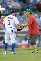 Actor Jim Belushi meets Tony Campana #1 in front of home plate after throwing out  the first pitch before a game between the Miami Marlins and the Chicago Cubs at Wrigley Field on July 17, 2012 in Chicago, Illinois. The Marlins defeated the Cubs 9-5. (Tony Farlow/Four Seam Images).