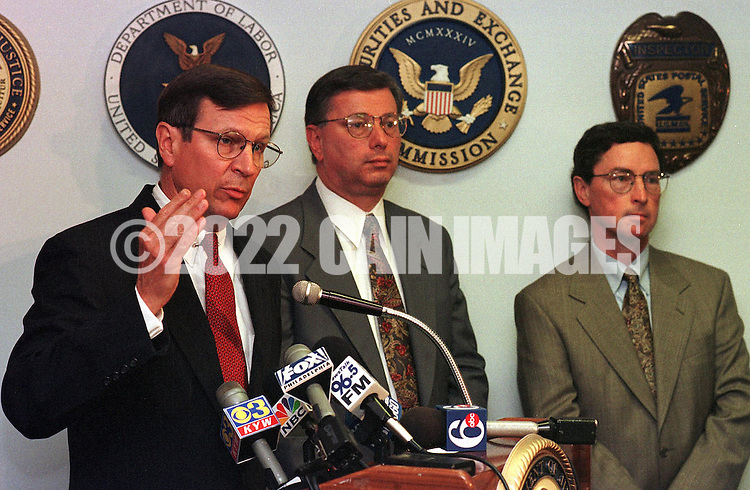 Michael R. Stiles, U. S. Attorney for Eastern District of  Pennsylvania, left, Robert S. Conforti, center, Special Agent-In-Charge, FBI, and Robert Courtney, U.S. Attorney, Organized Crime Strike Force, right, at a news conference announcing the charges brought against YBM,  Monday, June 7, 1999, in Philadelphia. YBM, a publicly traded Canadian Corporation, has been charged with conspiracy to commit mail fraud, and securities fraud in the U.S. (Photo by William Thomas Cain)