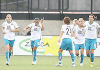 Marta #10 of Marta's XI greets her teammates after scoring during the WPS All-Star game against Abby's XI at the KSU Stadium in Kennesaw, Georgia on June 30 2010. Marta XI won 5-2.
