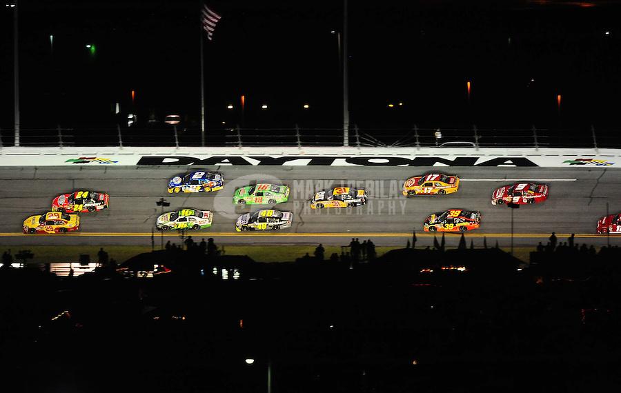Jul. 3, 2010; Daytona Beach, FL, USA; NASCAR Sprint Cup Series drivers Kevin Harvick (29) and Jeff Gordon (24) battle for the lead during the Coke Zero 400 at Daytona International Speedway. Mandatory Credit: Mark J. Rebilas-