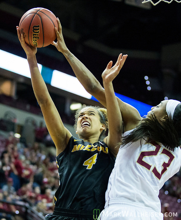 Florida State forward Ivey Slaughter blocks the shot of Missouri forward Cierra Porter during the first half of a second-round game of the NCAA women's college basketball tournament in Tallahassee, Fla., Sunday, March 19, 2017. (AP Photo/Mark Wallheiser)
