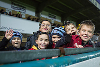 Young Wycombe supporters enjoy there day during the Sky Bet League 2 match between Wycombe Wanderers and Morecambe at Adams Park, High Wycombe, England on 2 January 2016. Photo by Andy Rowland / PRiME Media Images