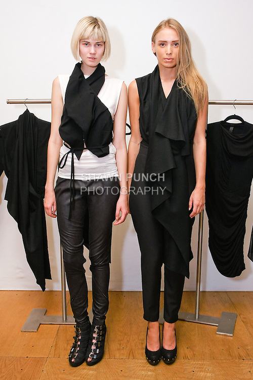 Models pose in outfit by Ji Oh, during the Shadowconnected S/S 11 presentation at Nexus Showroom, September 2nd, 2010.
