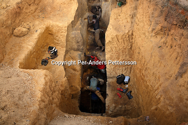 LUBUMBASHI, DEMOCRATIC REPUBLIC OF CONGO - DECEMBER 13: Men ascend from a pit in a cobalt mine where about 4,000 artisan miners dig on December 13, 2005 in Ruashi mine about 20 kilometers outside Lubumbashi, Congo, DRC. Some children as young as eight work in the mine under dangerous conditions. Every month a few of the miners are killed. Congo has one of the largest Copper deposits in the world and most of it is exported to China. It?s fueling the thirst for minerals for China?s economic boom. The young men who works in the mine makes a few US dollars a day, and the children much less. The mine is about one hundred years old and has been a source of wealth for the Katanga province for many years. In recent years many foreign companies and shady business people has moved into Congo to plunder its wealth. The country has no elected government and the corruption is rife. Border and customs officials are easily bribed. Congo has had a civil war since 1997 and it?s estimated that nearly 4 million people has died in fighting and because of lack of health care. (Photo: Per-Anders Pettersson/Getty Images)