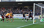 Peter Hartley gets to the rebound to score for Motherwell